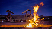 Flames from a flaring pit near a well in the Bakken Oil Field. The primary component of natural gas is methane, which is odorless when it comes directly out of the gas well. In addition to methane, natural gas typically contains other hydrocarbons such as ethane, propane, butane, and pentanes. Raw natural gas may also contain water vapor, hydrogen sulfide (H2S), carbon dioxide, helium, nitrogen, and other compounds. (Source: www.earthworksaction.org). <br /> As of July 2014, roughly 30 percent of the one billion cubic feet per day of natural gas produced in North Dakota was being wasted in flares like this, according to the news site Breaking  Energy. The reasons are low price on LNG (liquefied natural gas) , lax regulations and lack of infrastructure. In order to put an end to the flaring, North Dakota have adopted new regulations, and the goal is to capture 95 percent of the gas by 2020. <br /> On August 18th 2015, EPA announced that the oil and gas sector will have to cut their methane emissions by 40 to 45 percent within the next decade. Methane  is a shortlived greenhouse gas compared to CO2, but is 72 times more damaging. That