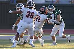 {BLOOMINGTON, IL: Bryce Dooley contacted by Daniel Herber during a college football game between the IWU Titans  and the Wheaton Thunder on September 15 2018 at Wilder Field in Tucci Stadium in Bloomington, IL. (Photo by Alan Look)