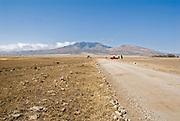 Road on the dry plains close to Olduvai Gorge, Tanzania.