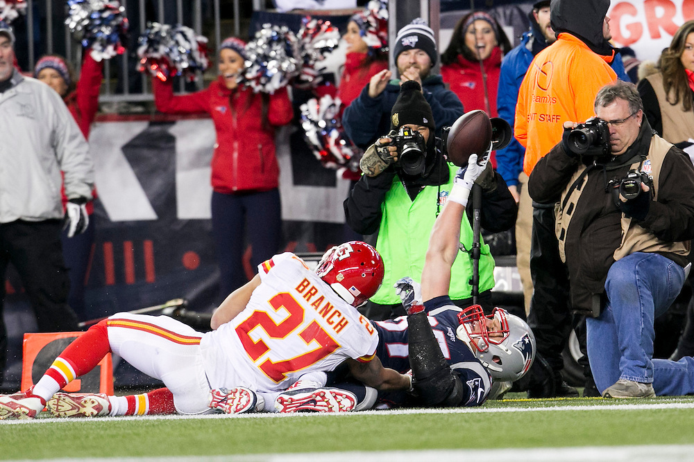 New England Patriots tight end Rob Gronkowski (87) shows possession of the football for the touchdown after being tackled by Kansas City Chiefs safety Tyvon Branch (27) in the third quarter of the AFC Divisional Playoff game at Gillette Stadium in Foxborough, Massachusetts on January 16, 2016. The Patriots defeated the Chiefs, 27-20.    Photo by Kelvin Ma/ UPI