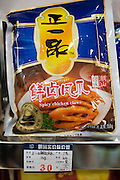 Bag of spicy chicken claws on sale in souvenir shop, Shanghai, China
