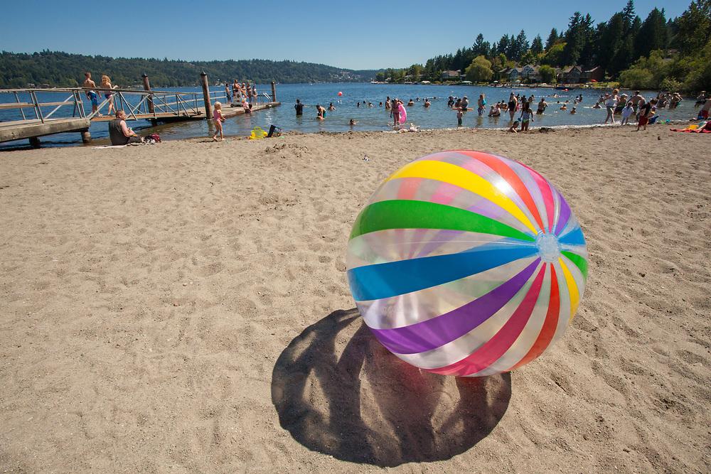 United States, Washington, Redmond, ball on beach at Idylwood Park on Lake Sammamish