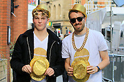 Spectators with gold medal hats during the Manchester Olympic Parade in Manchester, United Kingdom on 17 October 2016. Photo by Richard Holmes.