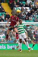 14th October 2017, Celtic Park, Glasgow, Scotland; Scottish Premiership football, Celtic versus Dundee; Dundee's Jack Hendry out jumps Celtic's Scott Sinclair