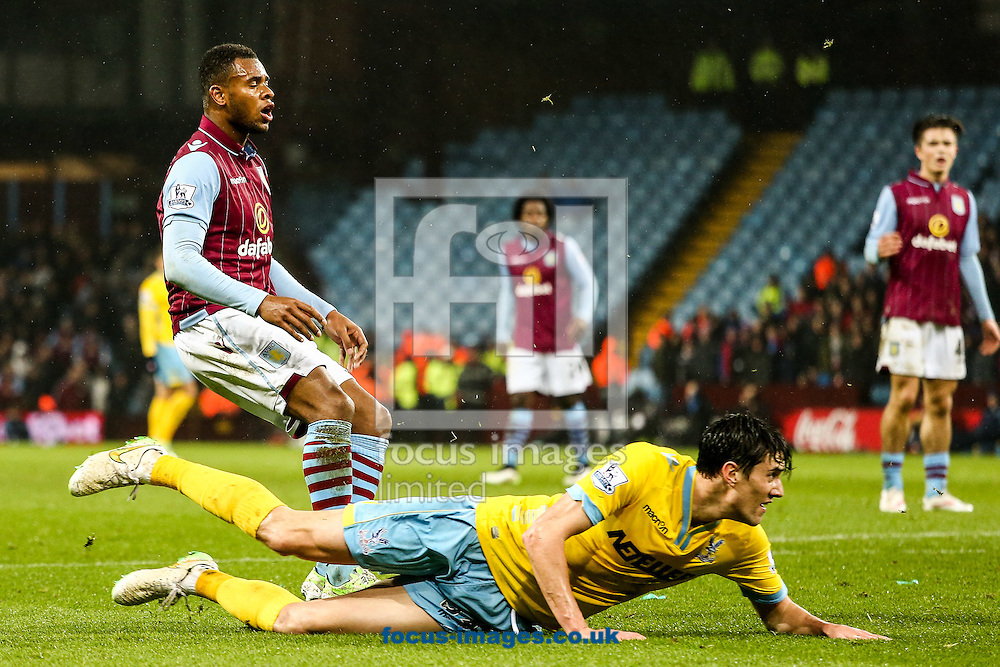 Leandro Bacuna of Aston Villa (left)  rues a near miss during the Barclays Premier League match at Villa Park, Birmingham<br /> Picture by Andy Kearns/Focus Images Ltd 0781 864 4264<br /> 01/01/2015