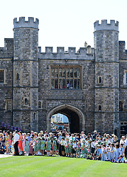 A general view of fans at St George's Chapel at Windsor Castle for the wedding of Meghan Markle and Prince Harry.