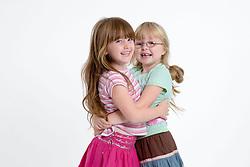 Little girls hugging,