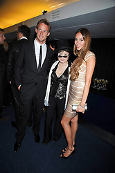 Left to right, JENSON BUTTON, YOKO ONO and JESSICA MICHIBATA at the annual GQ Awards held at the Royal Opera House, Covent Garden, London on 8th September 2009.