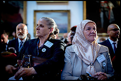 Image ©Licensed to i-Images Picture Agency. 08/07/2014. London, United Kingdom. Mothers l to r Hatidza Mehmedovic and  Mejra Duguz at the Srebrenica Memorial Reception at Lancaster House. Picture by Andrew Parsons / i-Images