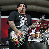 Marcos Curiel of the band POD plays guitar at the Rockstar Energy Drink Festival at the 1-800-Ask-Gary amphitheater in Tampa, Florida on Thursday, September 13, 2012. (AP Photo/Alex Menendez)