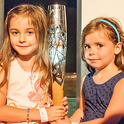 Sophie Steele and Olivia Cowles holding the Glasgow 2014 baton at an exhibition at the Old Fruit Markets that celebrates Scotland's sporting history and brings together some of the oldest trophies in Scottish and world sport. Scotland House, GLASGOW. 23 July 2014. (c) Paul J Roberts / StockPix.eu