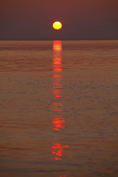 Sunrise during charter fishing on Lake Michigan near Sturgeon Bay, in Door County Wisconsin. (Mike Roemer Photography)