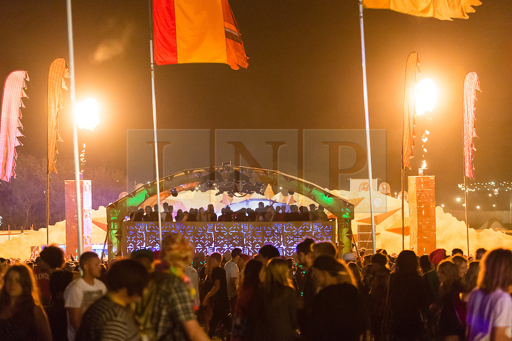 © Licensed to London News Pictures. 04/09/2014. Isle of Wight, UK. Flames shoot into the night sky as thousands of  festival goers dance to DJ's at Bestival 2014 Day 1.  The weather has been warm and sunny. Photo credit : Richard Isaac/LNP