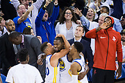 The Golden State Warriors celebrate a would-be game-winning basket by Golden State Warriors forward Kevin Durant (35), but referees called the shot released after the buzzer, during the home-opener loss to the Houston Rockets at Oracle Arena in Oakland, Calif., on October 17, 2017. (Stan Olszewski/Special to S.F. Examiner)