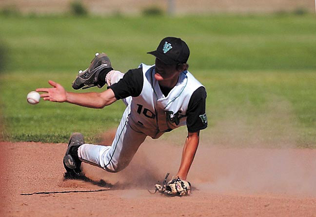 Victor Valley's #10 Mike Alvarez make a sliding catch and throws to first against Sierra Vista during the CFI championship game Thursday, May 19, 2005 at Victor Valley High School. Victor Valley won the game 11-5.