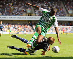 Yeovil Town's Michael Ngoo tangles with Millwall's Mark Beevers - Photo mandatory by-line: Seb Daly/JMP - Tel: Mobile: 07966 386802 03/08/2013 - SPORT - FOOTBALL - The Den - Millwall -  Millwall V Yeovil Town - Sky Bet Championship
