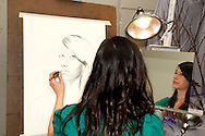 WSU junior Ashlee Malloris creates a self-portrait during the 13th Annual ArtsGala at Wright State University's Creative Arts Center, Saturday, March 31, 2012.