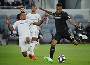 LAFC midfielder Mark-Anthony Kaye (14) dribbles past FC Dallas midfielder Bryan Acosta (8) during a MLS soccer match in Los Angeles, Thursday, May 16, 2019. LAFC defeated FC Dallas 2-0.  (Ed Ruvalcaba/Image of Sport)