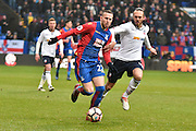 Crystal Palace Midfielder, Jordon Mutch (22) and Bolton Wanderers Defender, Tom Thorpe (32)  during the The FA Cup 3rd round match between Bolton Wanderers and Crystal Palace at the Macron Stadium, Bolton, England on 7 January 2017. Photo by Mark Pollitt.