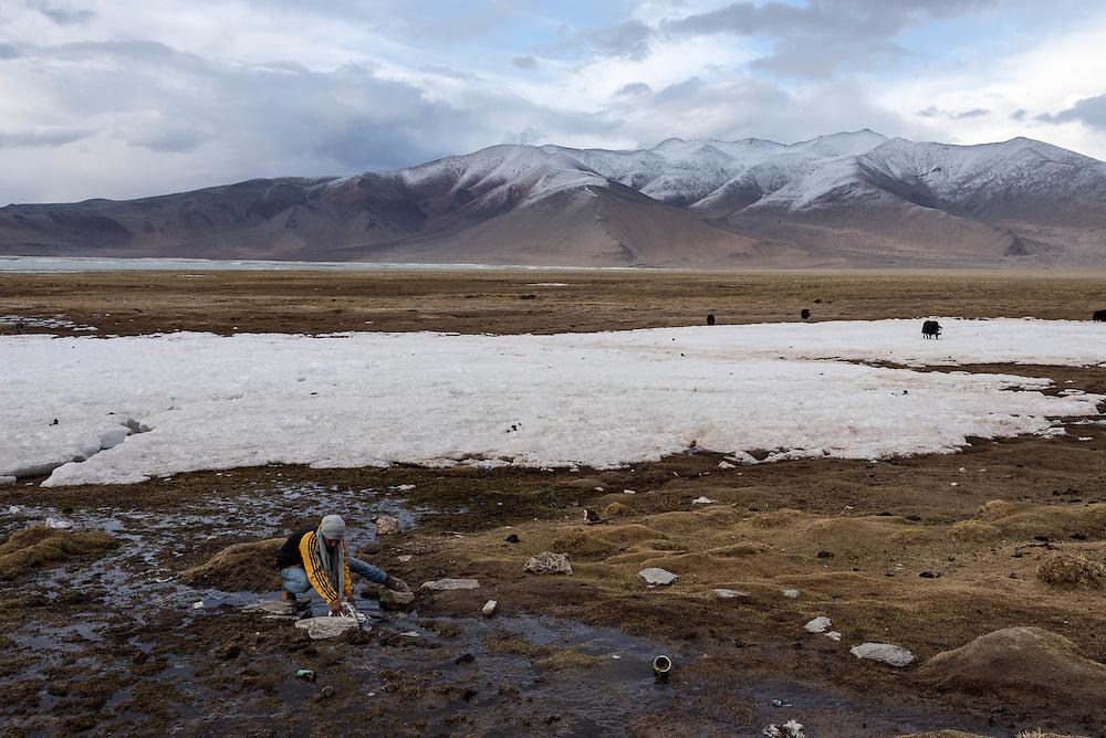 A Tibetan man gathers water on Ladakh's Changtang plateau near Tso Kar lake