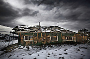 Nevada Ghost Towns-The remains of old, weathered buildings stand in Ione, Nevada. Founded in 1863 the Nye County mining town is still has a few residents. Colin E Braley (Wild West-Media)