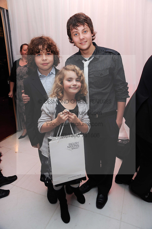 Left to right, DANIEL ROCHE, RAMONA MARQUEZ and TYGER DREW-HONEY at the launch of the English National Ballet's Christmas season 2009 held at the St.Martin;s Lane Hotel, London on 15th December 2009.