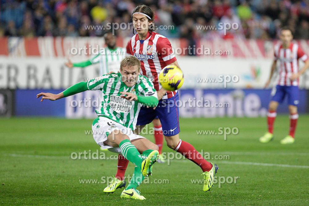 27.10.2013, Estadio Vicente Calderon, Madrid, ESP, Primera Division, Atletico Madrid vs Real Betis, 10. Runde, im Bild Atletico de Madrid's Filipe Luis (B) and Real Betis Perquis (L) // Atletico de Madrid's Filipe Luis (B) and Real Betis Perquis (L) during the Spanish Primera Division 10th round match between Club Atletico de Madrid and Real Betis at the Estadio Vicente Calderon in Madrid, Spain on 2013/10/28. EXPA Pictures &copy; 2013, PhotoCredit: EXPA/ Alterphotos/ Victor Blanco<br /> <br /> *****ATTENTION - OUT of ESP, SUI*****