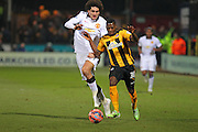 Cambridge United Sullay Kaikai battles with Manchester United's Marouane Fellaini during the The FA Cup match between Cambridge United and Manchester United at the R Costings Abbey Stadium, Cambridge, England on 23 January 2015. Photo by Phil Duncan.