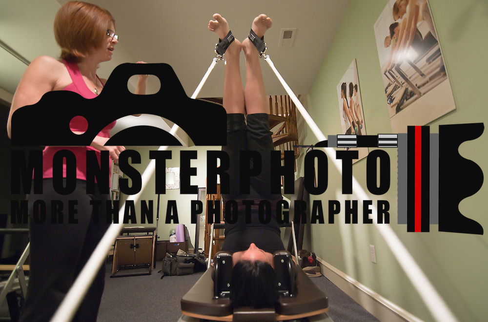 051011 Wilmington DE: 051011-24dh.get.fit-SS. Sarah Davis performs Short Spine Massage during a private Plates session with Wilmington Pilates instructor Patti McKelvey, which she does about 3 times a week..Special to The News Journal/SAQUAN STIMPSON..Pilates instructor Patti McKelvey.http://wwww.pilates.com