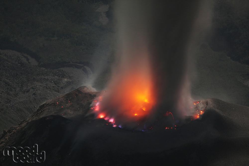 Molten lava glows in volcanic crater of Santiaguito Santa Maria Guatemala