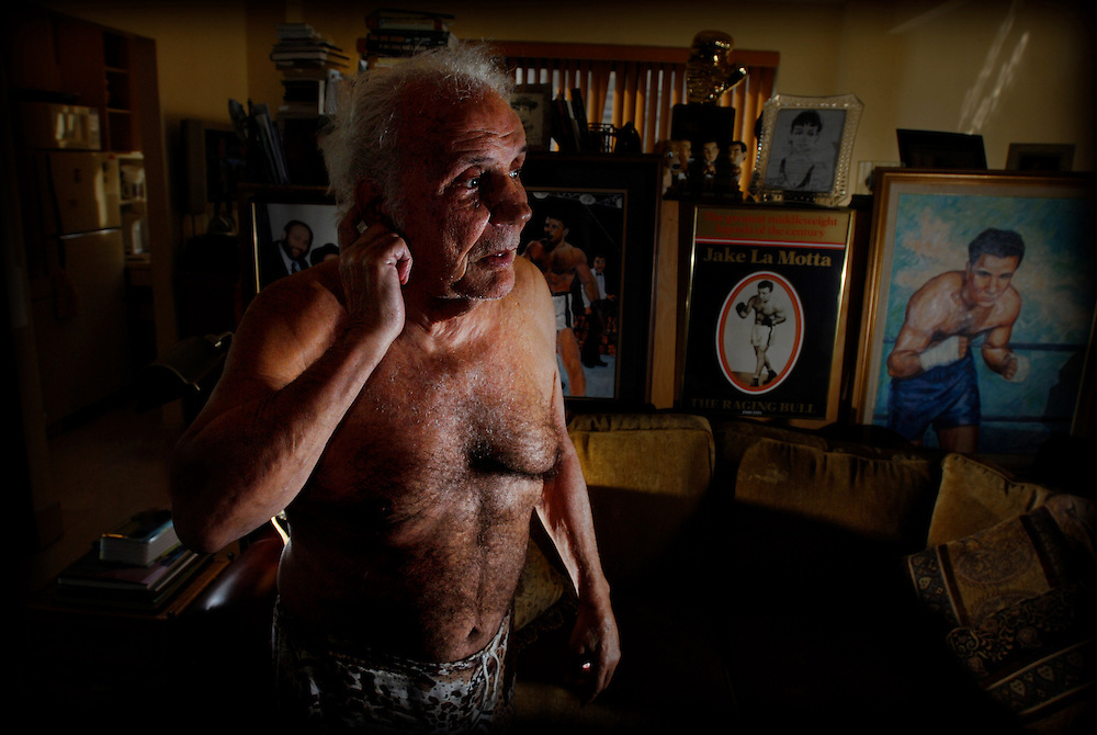 'The Raging Bull' Jake La Motta amongst  the memorabilia from his boxing career in his New York Apartment.