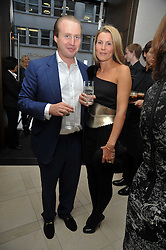 JOE BAMFORD and his wife ALEX at a reception hosted by Vogue and Burberry to celebrate the launch of Fashions Night Out - held at Burberry, 21-23 Bond Street, London on 10th September 2009.