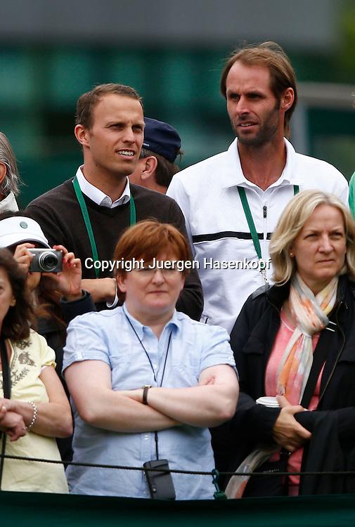 Wimbledon Championships 2013, AELTC,London,<br /> ITF Grand Slam Tennis Tournament, Angelique Kerber Manager Markus von Kotzebue (lks) und Trainer Torben Beltz stehen zwischen den Zuschauer und beobachten ein Spiel auf einem Nebenplatz,Halbkoerper,Hochformat,Feature,