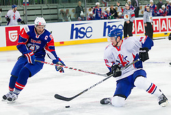 Tomaz Razingar of Slovenia vs David Phillips of Great Britain during ice-hockey match between Great Britain and Slovenia at IIHF World Championship DIV. I Group A Slovenia 2012, on April 15, 2012 in Arena Stozice, Ljubljana, Slovenia. Slovenia defeated Great Britain 3-2. (Photo by Vid Ponikvar / Sportida.com)