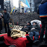 KIEV, UKRAINE - February 24, 2014: Members of Maidan's defence unit take a rest beside one of the many checkpoints outside Kiev's Independence Square. CREDIT: Paulo Nunes dos Santos
