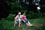 Peggy sits next to her daughter Charlotte as they wait for the end of a police roadblock in June 2011. Charlotte graduated high school  pregnant by choice although she is no longer in contact with the father. (photo by Shannon Jensen)