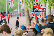 Queens 90th birthday was celebrated by the traditional Trooping the Colour as well as a flotilla on the river Thames.