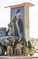 US. Army Soldiers from the 773 Transportation Company pulled their fuel tanker up to a large Saddam Icon so that they could write graffiti on the face. Several members of the company are New York Police and Firemen, and they had personal messages to write on the icon. This was located at Tallil air base in Southern Iraq. (Alan Lessig/Army Times)