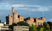 Inverness Castle overlooks the River Ness, in Inverness, Scotland, United Kingdom, Europe. The red sandstone structure was built in 1836 by architect William Burn on the site of an 11th-century fort. Today, it houses Inverness Sheriff Court. In April 2017 the north tower of the castle was opened to the public as a view point.