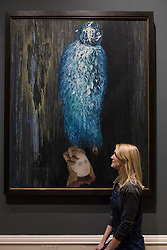 A major painting by one of the legendary figures of Surrealist art has been acquired by the Scottish National Gallery of Modern Art in Edinburgh and will go on public display for the first time this week. The Message of the Forest, which was painted in 1936, is widely acknowledged to be the greatest work by the Czech artist known as Toyen, and is the first of her paintings to enter a UK public collection.  It was acquired with support from the Walton Fund and Art Fund.<br /> <br /> Pictured: Press Officer, Jena Connolly with The Message of the Forest