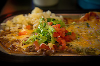 """Santa Fe, New Mexico - September 28, 2014: Huevos Rancheras at Plaza Cafe in Santa Fe, served """"Christmas style"""" with both red and green chiles. The Plaza Cafe is Santa Fe's oldest restaurant, dating back to 1905. Despite it's location in the heart of the tourist-oriented plaza area, the Plaza Cafe has remained a favorite of locals. CREDIT: Chris Carmichael for the New York Times"""
