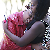 Paula Todd (left) is comforted by friend Latoya Warren outside a courthouse where a man jailed on a murder charge in the death of Todd's son, George Bennet, had a bond hearing Sunday morning. (ANDREW KNAPP/STAFF)