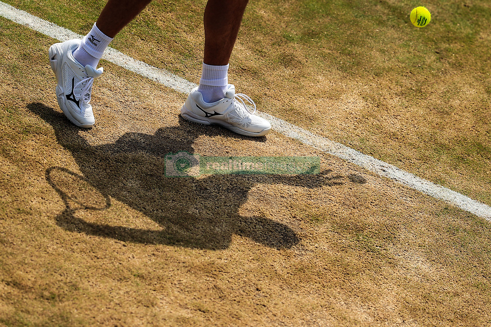 6 July 2017 -  Wimbledon Tennis (Day 4) - A silhouette of a players serving the ball - Photo: Marc Atkins / Offside.