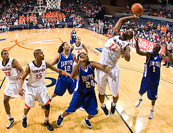 Virginia forward Jamil Tucker (12) grabs a rebound against Hampton.  The Virginia Cavaliers defeated the Hampton Pirates 74-48 at the John Paul Jones Arena on the Grounds of the University of Virginia in Charlottesville, VA on December 23, 2008. (Special to the Daily Progress / Jason O. Watson)