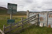 Rusted corrugated iron in abandoned livestock farm pens in Glen Bauchor, Newtonmore, Scotland.