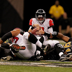 2009 November 02: New Orleans Saints defensive end Will Smith (91) sacks Atlanta Falcons quarterback Matt Ryan (2) during the first half at the Louisiana Superdome in New Orleans, Louisiana.