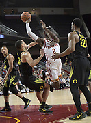 Feb 15, 2018; Los Angeles, CA, USA; Southern California Trojans guard Jonah Mathews (2) is defended by Oregon Ducks forward Paul White (13)a nd forward MiKyle McIntosh (22) during an NCAA basketball game at Galen Center. USC defeated Oregon 72-70.
