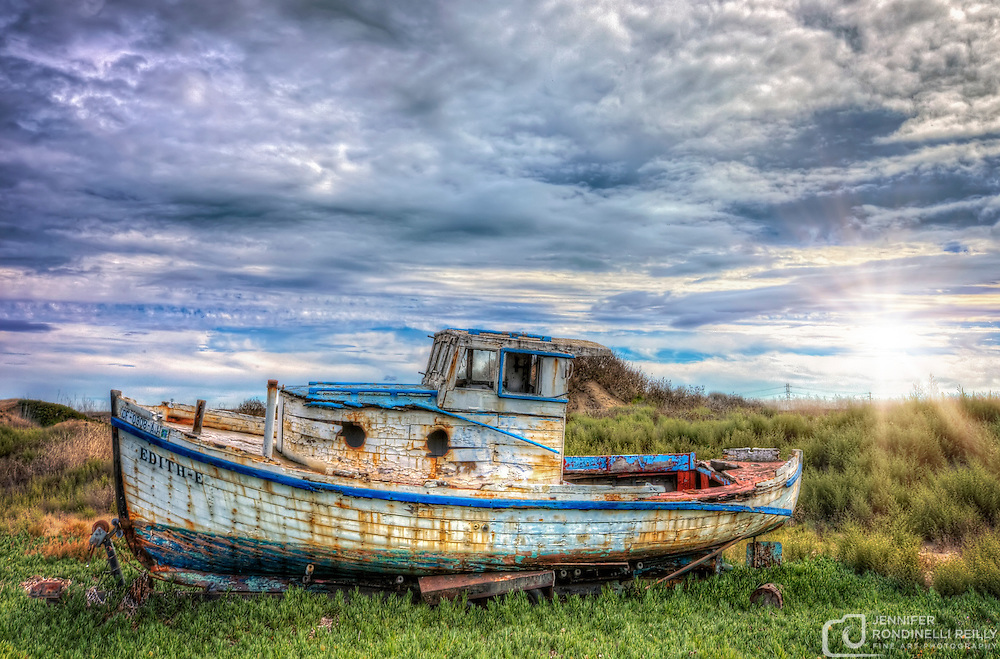 Photo of the Edith-E fishing boat. This abandonded vessel can be found on the side on HWY 37 near Port Sonoma Marina in Petaluma, CA.