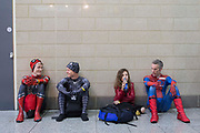 UNITED KINGDOM, London: 27 May 2018 Cosplay fans Martin Small, Chris Locke, Charlotte Lasseter aged 10 and Marc Lasseter take a break at the MCM London Comic Con earlier today. The three day comic convention, which is held at London's ExCeL, was visited by thousands of avid cosplay fans and enthusiasts. Rick Findler / Story Picture Agency