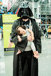 October 4, 2018 - New York, New York, U.S. - Darth Vader with baby. Cosplayers in costume during day one of the New York Comic Con. (Credit Image: © Mark Ashe/ZUMA Wire/ZUMAPRESS.com)